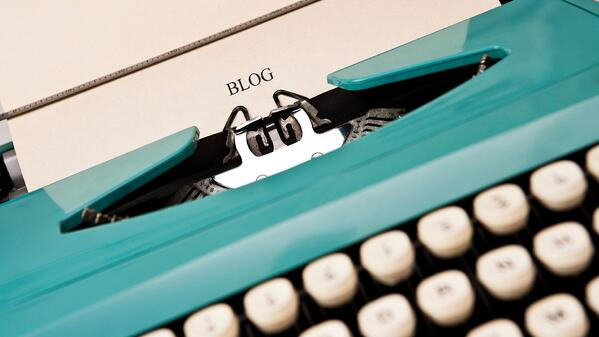 Blog text on white paper