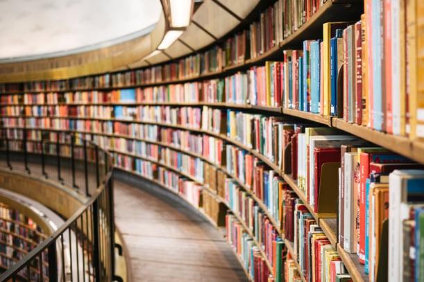 Books on shelfs on library