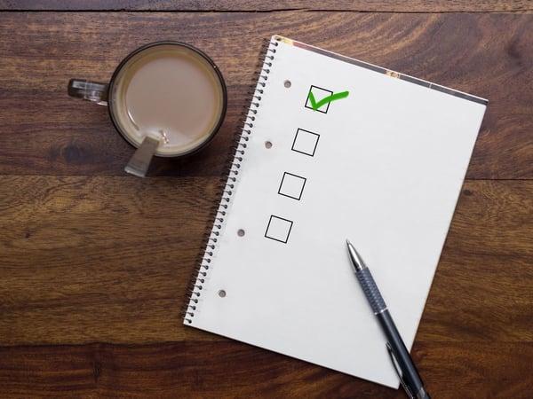 Checklist notepad near coffee