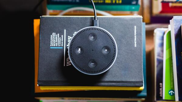 Echo Dot on top of stack of books