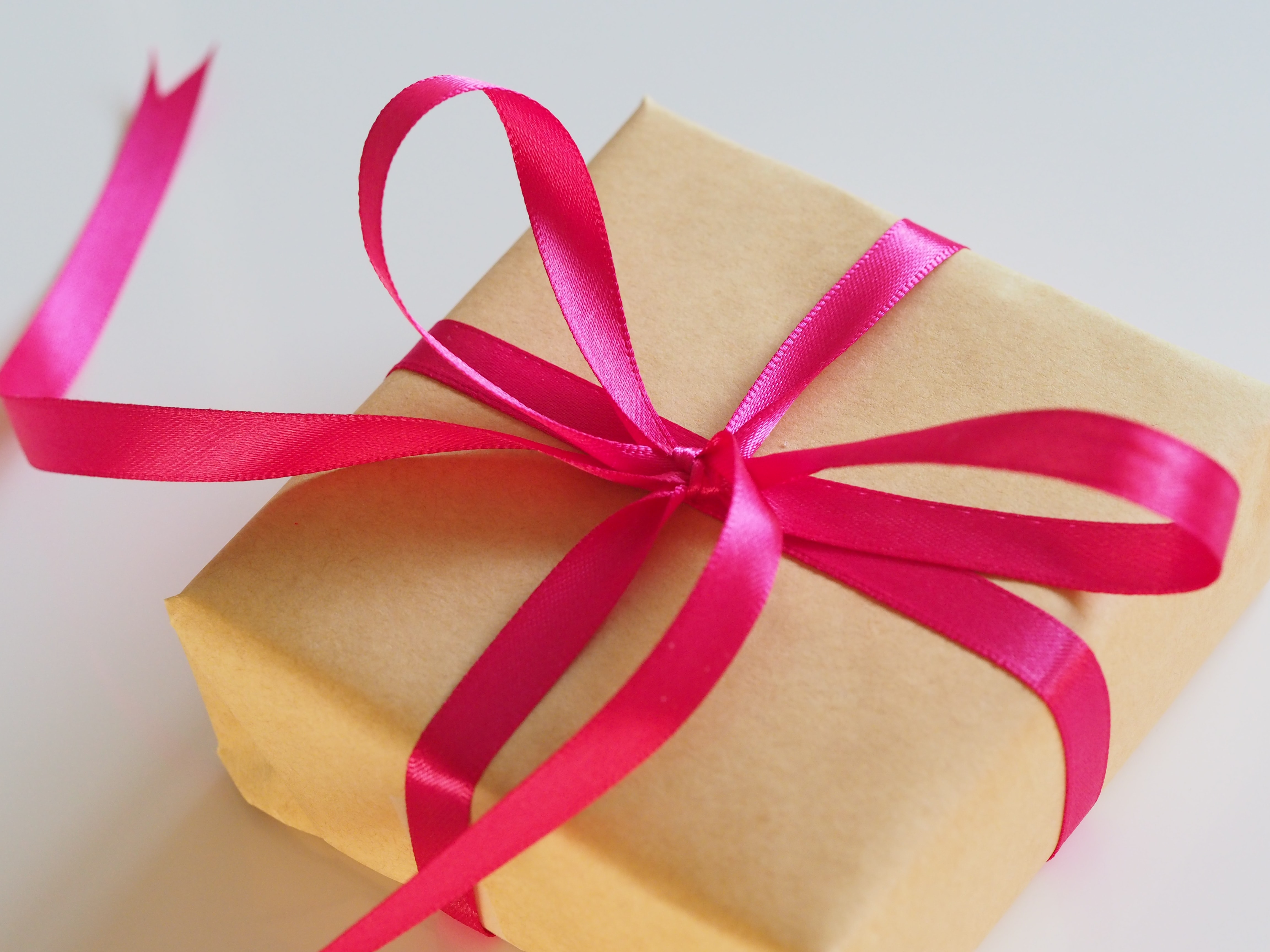 Gift wrapped in brown paper with pink ribbon