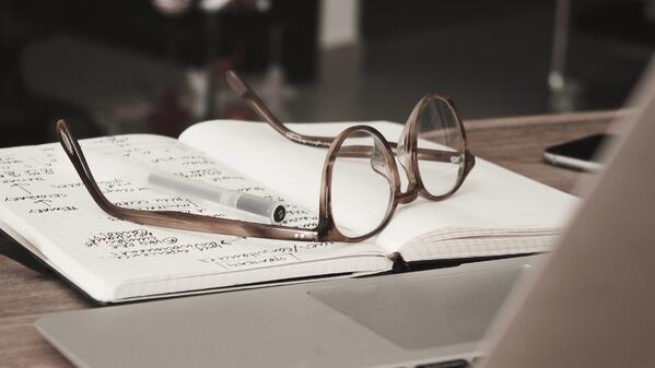 Glasses resting on a notebook