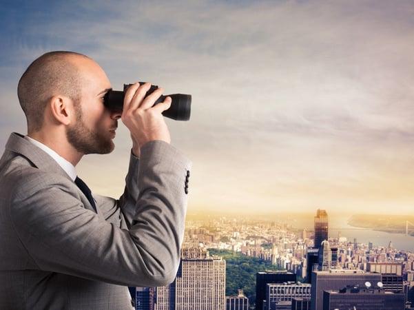 Man looking through binoculars2