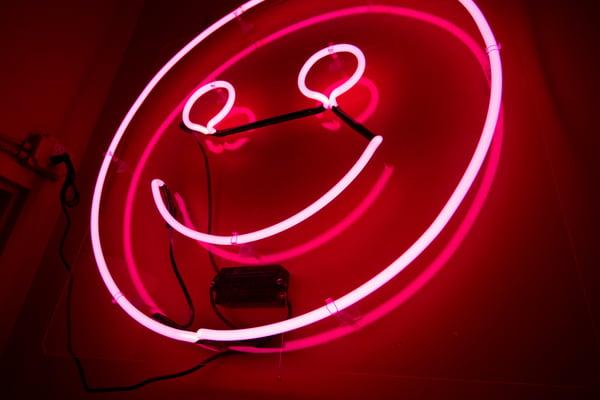 Neon light smiley face