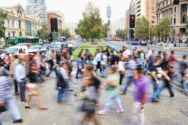 People crossing the street blurred