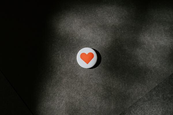 Red love heart on white button