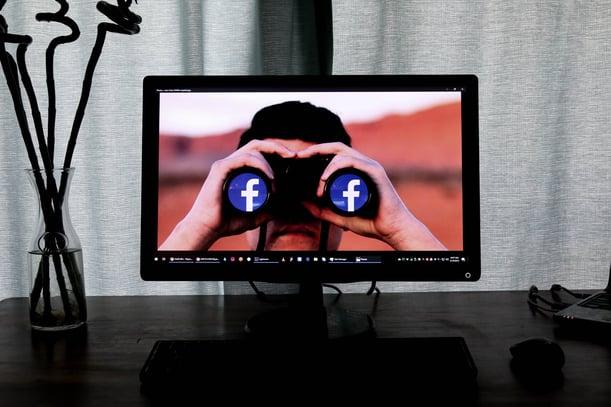 TV showing man using binoculars