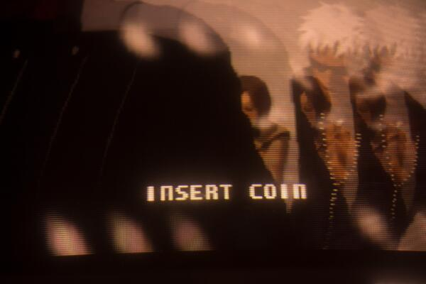 """Video game screen reading """"insert coin"""""""