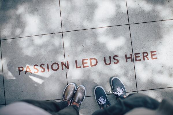 """""""Passion led us here"""" written on the pavement"""