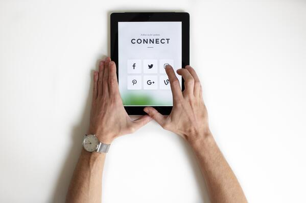 Six social media platforms shown on black iPad